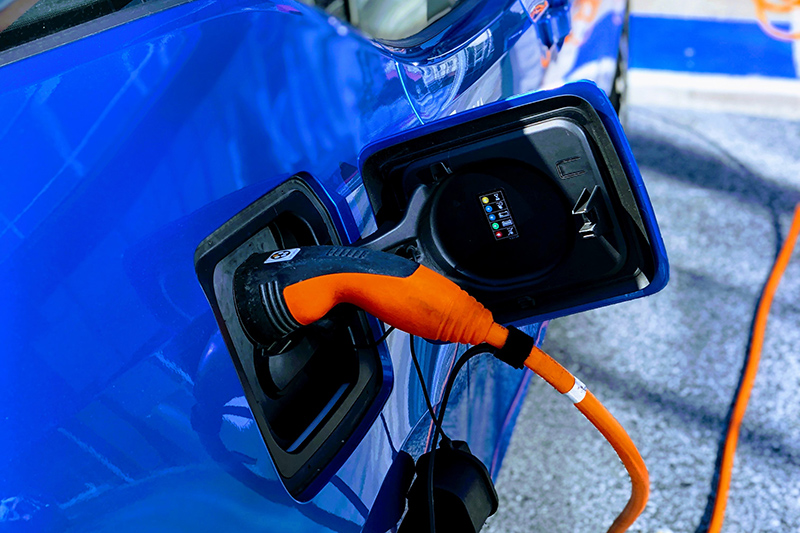 an electric vehicle that's plugged in getting charged