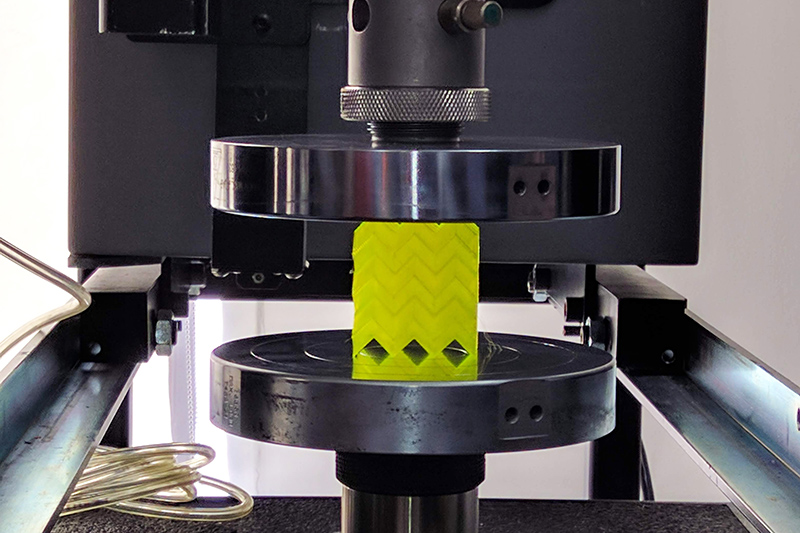 a cube of metacore in a mechanical tester